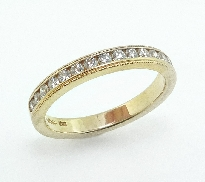 18K yellow gold band; known as  Eterne Milgrain Wedding Band  by Hearts On Fire -set with ideal round brilliant cut diamonds by Hearts On Fire; 0.29 carat total weight; VS-SI; I/J