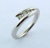 14K White Gold Band. Set with 5; ideal round brilliant cut Hearts On Fire diamonds; 0.202 carat total weight SI G/H