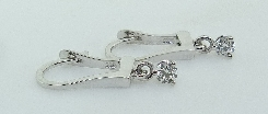 14K white gold earrings; three prong set with two G-H SI1 ideal cut round brilliant cut diamonds by Hearts On Fire; totaling 0.185 carats.
