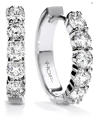 18K white gold earrings known as   Mini Hoop   by Hearts On Fire. Set with ideal round brilliant cut diamonds by Hearts On Fire; 0.60 carat total weight; SI1-VS2; G-H