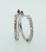 14KW HOF hoop earrings claw set with: - 24 ideal cut; round brilliant cut Hearts On Fire diamonds; 0.158cttw; G/H; SI1