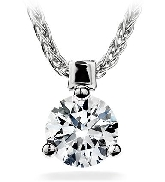 18 karat white gold three prong pendant; set with one ideal round brilliant cut diamond by Hearts On Fire; 0.157ct SI; G/H