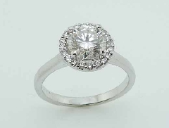 18 karat white gold mount set with: - 0.14 carat total weight; F/G VS - 6.5mm (1ct size) moissanite
