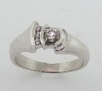 14K white gold engagement ring; semi-bezel set with one 0.32 carat H VS2 very good cut round brilliant cut diamond. Accented with three H SI1 round brilliant cut diamonds; totaling 0.063 carats.