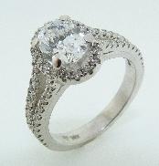 Diamond Engagement Ring designed by Studio Tzela  14 karat white gold set with: 1.0 ct CZ in the center - 18 x 1.3mm 0.157 cttw F/G; VS/SI excellent cut diamonds - 40 x 1.2mm 0.282 cttw F/G; VS/SI excellent cut diamonds