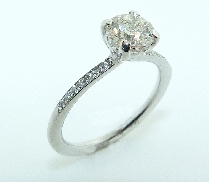 18 karat white gold diamond engagement ring by Studio Tzela; set with 0.75ct CZ center; Accented with 14 round brilliant cut diamonds by Hearts On Fire diamonds; totaling 0.067 carats; G/H; VS- SI.