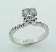 One lady s 14K white gold diamond engagement ring. Set with 28 round brilliant cut diamonds totalling 0.165carats; SI1/VS2; F/G excellent cut.  Set in the center with a 0.75ct CZ