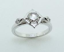 14KW diamond engagement ring by Studio Tzela set with: - 0.48ct rose cut diamond; F/G; SI1 - 2 round brilliant cut diamonds; 0.054 cttw; G/H; SI