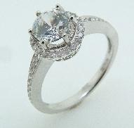 18 karat; 6 prong; halo white gold Ladies diamond engagement ring by Natalie K set with: - 1 carat CZ - 40 - 0.20 carat total weight round brillant cut diamonds