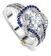 14 karat white gold engagement ring by Mark Schneider designs; known as   Entangle   Set with a 0.75 carat cubic zirconia.  Accented with Blue Sapphires