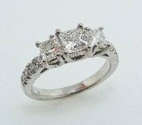 Diamond Engagement Ring 14 K white gold Set with: -Firemark diamonds  0.56ct H VS2  0.40ct H VS1  0.40ct H VS2 -8*= 0.167ct GH SI1 good cut round