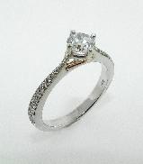 14KW diamond engagement ring set with:  - 0.50ct CZ  - 20 RBC diamonds; 0.14cttw; G/H; SI very good cut