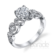 18 karat white gold engagement ring; part of the Hera Bridal Collection by Parade Designs. Set with CZ center. Accented with 14 very good cut diamonds; 0.13 carat total weight; G/H; SI.