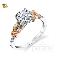 18 karat white and rose gold engagement ring; part of the Reverie Collection by Parade Designs. Set with CZ Center. Accented with 2 fancy diamonds; 0.16 carat total weight. Accented with 12 very good diamonds; 0.06 carat total weight; G/H; SI.