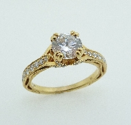 18 karat yellow gold engagement ring; known as   Hera Bridal   by Parade Designs. Set with Cubic Ziconia center. Accented with round brilliant cut diamonds; 0.30 carat total weight; G/H VS-SI