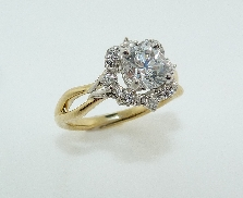 18 karat white and yellow gold diamond engagement ring by Parade set with: - 56 round brillant diamonds - 0.36 cttw