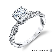 18KW engagement ring by Parade Design set with: - 1.0 ct CZ centre - 30 round brilliant cut diamonds; 0.23cttw; G/H; SI