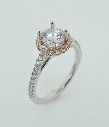 18 KWR engagement ring by Parade Design set with: - 0.75 ct CZ - 36 round brilliant cut diamonds; 0.27cttw; G/H; SI
