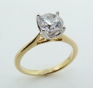 18KYW engagement ring by Parade Design set with: - 1.25 ct CZ
