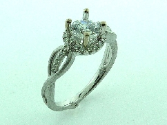 18KW engagement ring by Parade Designs set with: - 0.75 ct CZ - 32 round brilliant cut diamonds; 0.15cttw; G/H; SI
