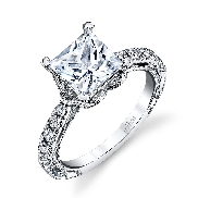 18KW engagement ring by Parade Design set with: - 1 ct Princess cut CZ - 12 round brilliant cut diamonds; 0.33 ct; G/H; SI