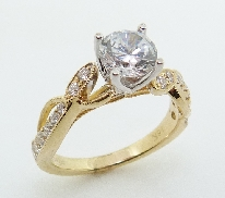 18KYW engagement ring by Parade Designs set with: - 1.0 ct CZ - 16 round brilliant cut diamond; 0.45cttw; G/H; SI