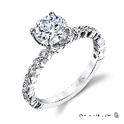 18KW engagement ring by Parade Design set with: - 0.75 ct CZ - 18 round brilliant cut diamonds; 0.21cttw; G/H; SI
