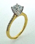 18KYW engagement ring by Parade Designs set with: - 1.0 ct CZ - 18 round brilliant cut diamonds; 0.13cttw; G/H; SI