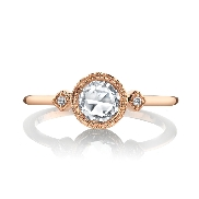 18 karat rose gold engagment ring set with: -One 0.38 carat rose cut diamond -On the sides are two round brilliant cut diamonds totalling 0.02 carats