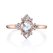 18 karat rose gold engagement ring set with: -One 0.50 carat Rose cut diamond in the centre -On the sides are eight round brilliant cut diamonds totalling 0.36 carats