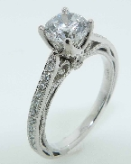 18KW Parade engagement ring set with: - 1.0 ct CZ  - 26 round brilliant cut diamonds; 0.19cttw; G/H; VS-SI