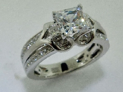 14 Karat white gold diamond engagement ring by Frederic Sage set with: - 1 carat CZ - 48 - 0.18 cttw diamonds