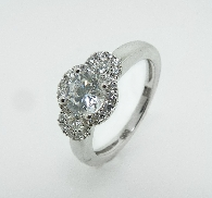 14K white gold engagement ring by Frederic Sage set with:  - 0.75ct CZ center - 26-0.32cttw diamonds