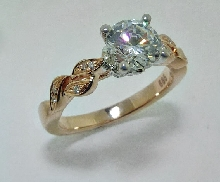14K white and rose gold diamond engagement ring by Frederic Sage set with:  - 1.00ct CZ center - 18-0.07cttw
