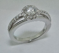 14 karat white gold diamond engagement ring by Frederic Sage set with: - 0.5 ct CZ centre - 32 - 0.28 cttw diamonds