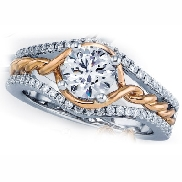 14 karat white and yellow gold diamond engagement by Frederic Sage set with: - 0.75 carat CZ - 58 - 0.32 cttw diamonds