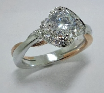 14K white and rose gold diamond engagement ring by Frederic Sage set with:   - 0.75ct CZ center   - 26-0.17cttw