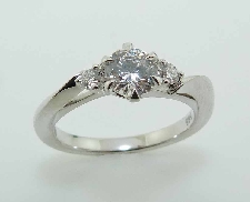 14KW diamond enagement ring by Frederic Sage set with: - 0.50ct CZ  - 2 RBC diamonds; 0.10cttw; G/H; VS-SI