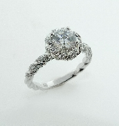 14KW engagment ring by Frederic Sage set with: - 0.75ct CZ  - 70 round brilliant cut diamonds; 0.40cttw; G/H; VS-SI