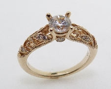 14K yellow gold engagement ring by Sylvie set with:  - 0.50ct cubic center  - 0.12cttw