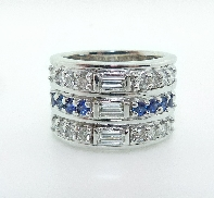 Diamond ring; 14K white gold; claw-set with three G-H VS baguettes; totaling 0.314 carats. Accented with sixteen I-J I1 round brilliant cut diamonds; totaling 0.708 carats; and eight round blue sapphires; totaling 0.419 carats.