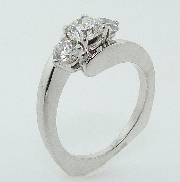 14K white gold diamond engagement ring; claw-set with one 0.47 carats H SI2 ideal round brilliant cut diamond and two H-I VS excellent round brilliant cut diamonds; totaling 0.47 carats.