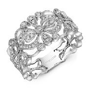 14KW lady s diamond dinner ring set with: - 65 RBC diamonds; 0.33cttw; G/H; SI very good cut