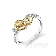 18KWY ladies dinner ring by Parade Design set with: - a pear and marquise diamond = 0.34 cttw - 19 round brilliant cut diamonds - 0.23 cttw; G/H; SI