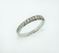 14K white gold antique style wedding band. Pave set diamonds totalling 0.30 carats; SI-VS; G-H