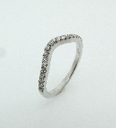 18K white gold wedding band by Natalie K. Accented with 26 G-H SI round brilliant cut diamonds totaling 0.09 carats.