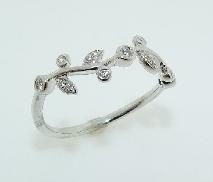 14K white gold diamond band set with::  - 15*=0.10cttw diamonds