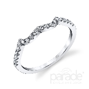 18 karat white gold wedding band; part of the Lyria Bridal Collection by Parade Designs. Accented with 21 very good cut diamonds; 0.19 carat total weight; G/H; SI.