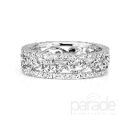 18 karat white gold band; part of the Lyria Leaves Collection by Parade Designs. Set with 51 very good cut diamonds; 0.33 carat total weight; G/H SI. 5.7 mm.