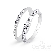 18KW set of two diamond ladies bands by Parade Designs set with: - 56 round brilliant cut diamonds; 0.36cttw; G/H; SI